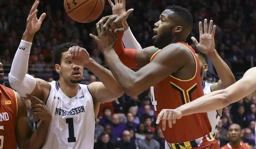 Maryland forward Robert Carter (4) and Northwestern forward Joey van Zegeren (1) go for a loose ball during the first half of an NCAA college basketball game Saturday, Jan. 2, 2016, in Evanston, Ill. (AP Photo/David Banks)