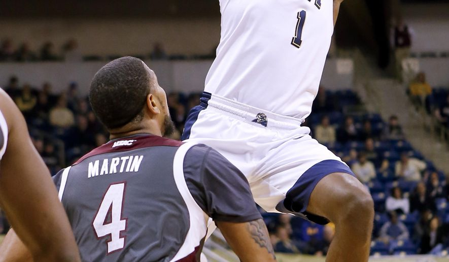 Pittsburgh's Jamel Artis (1) passes as Maryland-Eastern Shore's Devin Martin (4) defends during the first half of an NCAA college basketball game, Saturday, Jan. 2, 2016, in Pittsburgh. (AP Photo/Keith Srakocic)