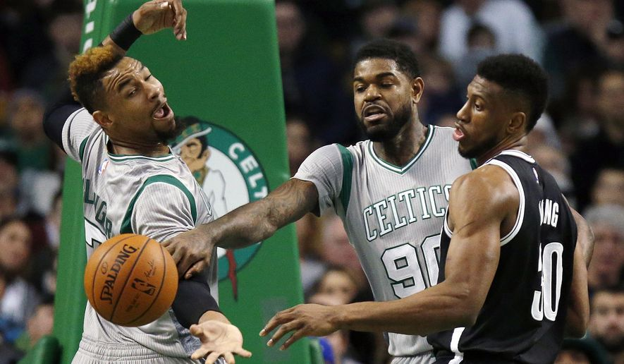 Boston Celtics' Jared Sullinger, left, Amir Johnson (90) and Brooklyn Nets' Thaddeus Young (30) battle for the ball during the first quarter of an NBA basketball game in Boston, Saturday, Jan. 2, 2016. (AP Photo/Michael Dwyer)