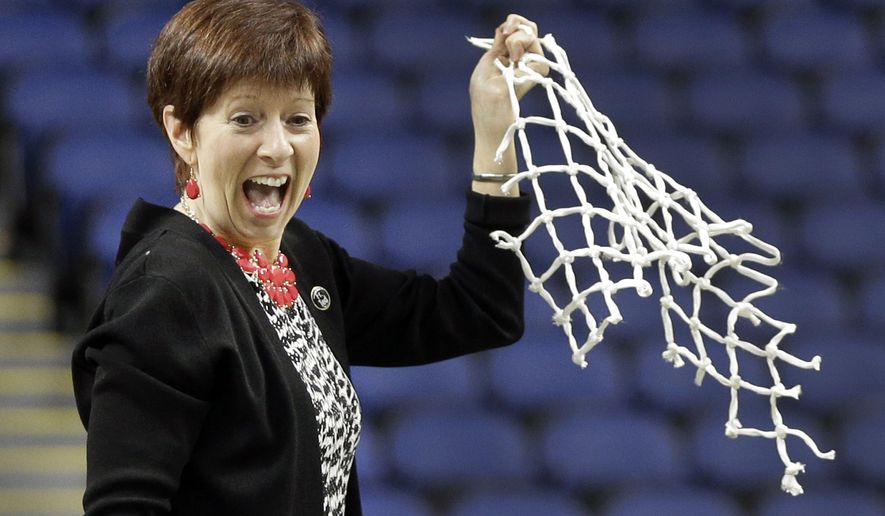FILE - In this March 8, 2015, file photo, Notre Dame head coach Muffet McGraw reacts after cutting down the net after an NCAA college basketball game against Florida State in the championship of the Atlantic Coast Conference tournament in Greensboro, N.C. McGraw has built Notre Dame into one of the elite women's basketball programs during her 29 years at the school. Now she's on the brink of reaching another coaching milestone, 800 victories, and doesn't show any signs of slowing down anytime soon. (AP Photo/Chuck Burton, File)