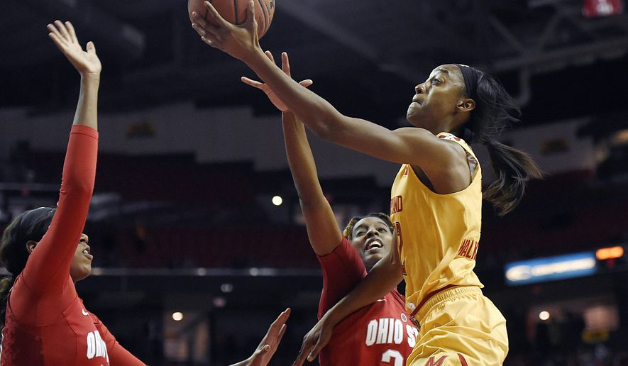 Maryland's Shatori Walker-Kimbrough, right, shoots against Ohio State during the first half of an NCAA college basketball game, Saturday, Jan. 2, 2016, in College Park, Md. (AP Photo/Gail Burton)