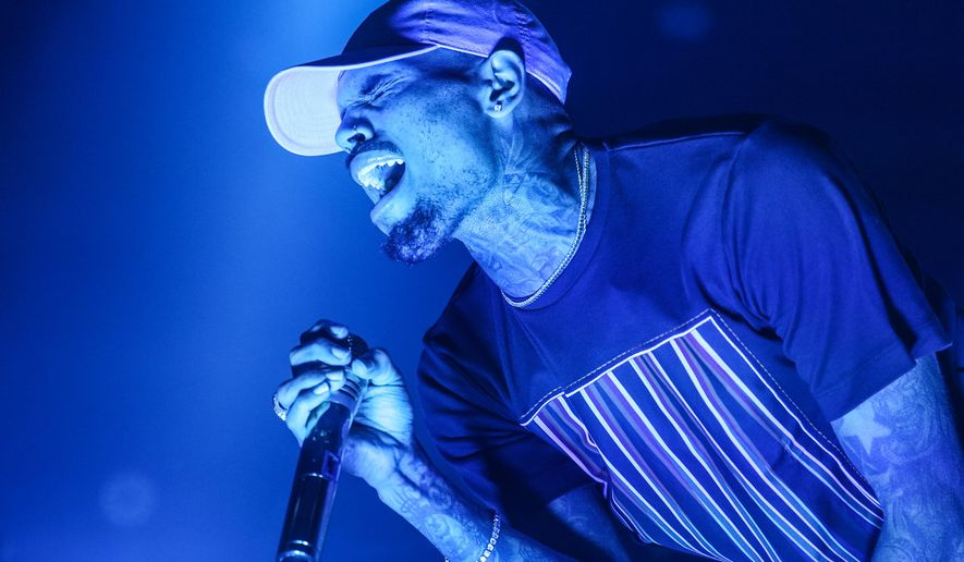 FILE - In this Friday, Dec. 18, 2015 file photo, Chris Brown performs at the Hollywood Palladium in Los Angeles. Las Vegas police are investigating an allegation of battery against R&B singer Chris Brown. Lt. Jeff Goodwin said authorities received a call Saturday, Jan. 2, 2016, about the alleged battery at the Palms Casino Resort. (Photo by Rich Fury/Invision/AP, File)
