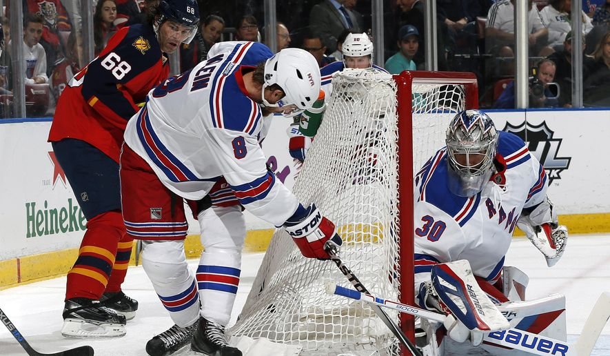 New York Rangers defenseman Kevin Klein (8) assists goaltender Henrik Lundqvist (30) to defend the net with Florida Panthers forward Jaromir Jagr (68) looking from behind during the first period of an NHL hockey game, Saturday, Jan. 2, 2016, in Sunrise, Fla. (AP Photo/Joel Auerbach)