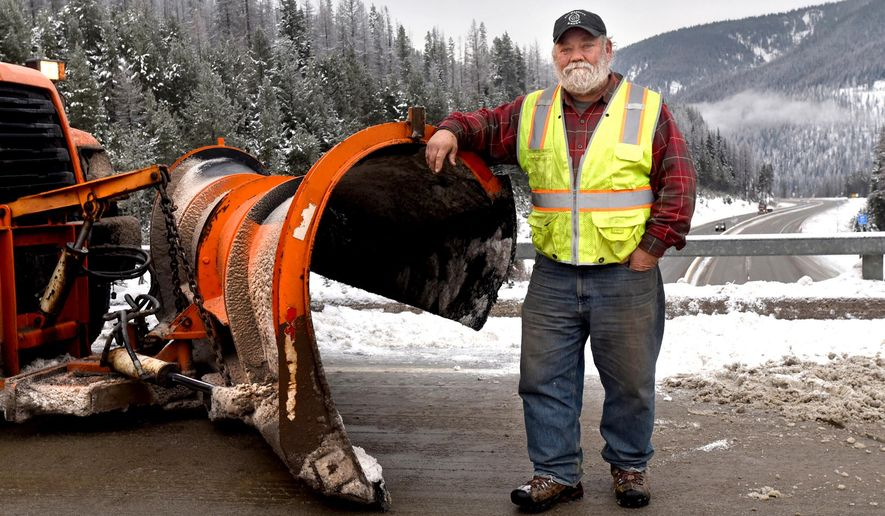 """Look at this. Not a bad place to work,"" says Denley Loge, who has spent 40 of the last 45 years working on Interstate 90 near Lookout Pass where this photo was taken Dec. 3. After a series of road construction jobs on the stretch, Loge joined the Montana Department of Transportation in 1987 and is stepping down at the end of December as Lookout Pass section supervisor for the MDT. (Kurt Wilson/Missoulian via AP)"