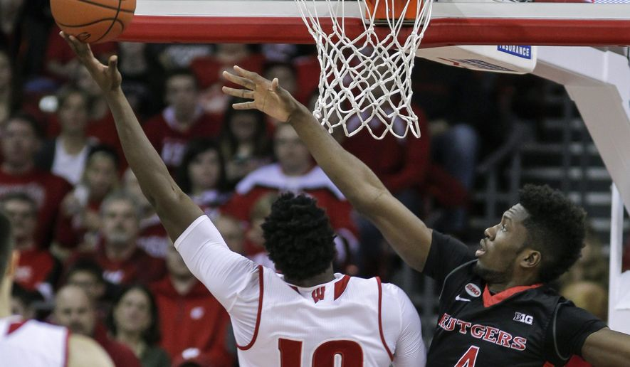 Wisconsin's Nigel Hayes (10) shoots against Rutgers' Jonathan Laurent (4) during the first half of an NCAA college basketball game Saturday, Jan. 2, 2016, in Madison, Wis. (AP Photo/Andy Manis)