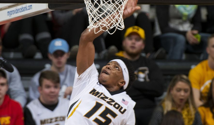 Missouri's Wes Clark, top, scores two of his game high 22 points during the second half of an NCAA college basketball game against Savannah State, Saturday, Jan. 2, 2016, in Columbia, Mo. Missouri won the game 81-50. (AP Photo/L.G. Patterson)