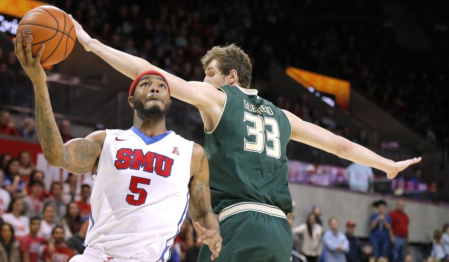 SMU forward Markus Kenedy (5) battles South Florida forward Ruben Guerrero (33) for space during the second half of an NCAA college basketball game Saturday, Jan. 2, 2016, in Dallas. SMU won 72-58. (AP Photo/Brandon Wade)