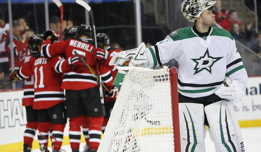 New Jersey Devils players celebrate a goal as Dallas Stars goalie Antti Niemi, right, of Finland, looks on during the second period of an NHL hockey game, Saturday, Jan. 2, 2016, in Newark, N.J. (AP Photo/Julio Cortez)