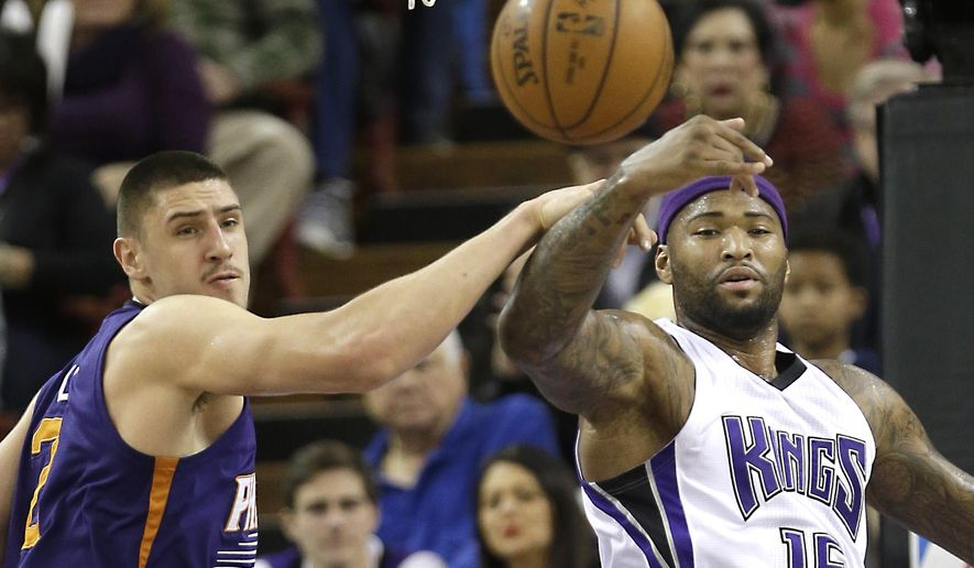 Phoenix Suns center Alex Len, left, and Sacramento Kings forward DeMarcus Cousins go for a rebound during the first half of an NBA basketball game Saturday, Jan. 2, 2016, in Sacramento, Calif.(AP Photo/Rich Pedroncelli)