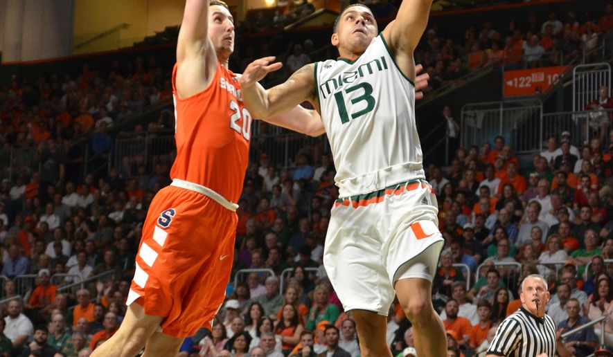 Miami guard Angel Rodriguez goes up for a lay up against Syracuse's Tyler Lydon during the first half of an NCAA college basketball game in Coral Gables, Fla., Saturday, Jan. 2, 2016. (AP Photo/Gaston De Cardenas)