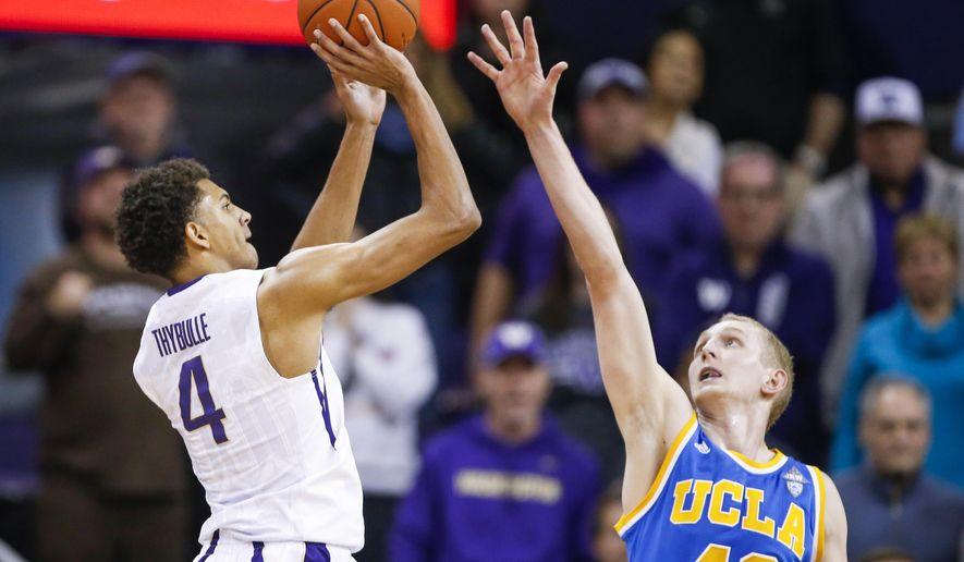 Washington forward Matisse Thybulle (4) shoots against UCLA center Thomas Welsh (40) during the first overtime of an NCAA college basketball game Friday, Jan. 1, 2016, in Seattle. (AP Photo/Joe Nicholson)