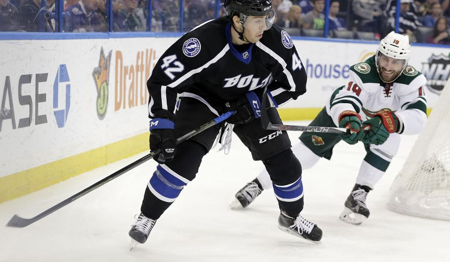Tampa Bay Lightning center Jonathan Marchessault (42) carries the puck past Minnesota Wild center Jarret Stoll (19) during the second period of an NHL hockey game Saturday, Jan. 2, 2016, in Tampa, Fla. (AP Photo/Chris O'Meara)