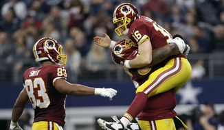 Washington Redskins' Alex Smith (83) and Spencer Long, carrying Colt McCoy (16), celebrate a long pass caught by Rashad Ross for a touchdown in the second half of an NFL football game against the Dallas Cowboys, Sunday, Jan. 3, 2016, in Arlington, Texas. (AP Photo/Tim Sharp)