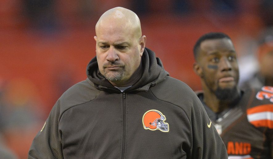 Cleveland Browns head coach Mike Pettine walks off the field after the Browns lost to the Pittsburgh Steelers 28-12 in an NFL football game, Sunday, Jan. 3, 2016, in Cleveland. (AP Photo/David Richard)