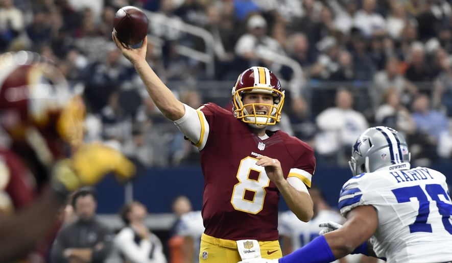 Washington Redskins quarterback Kirk Cousins (8) looks to throw a pass  under pressure from 31d0f1143