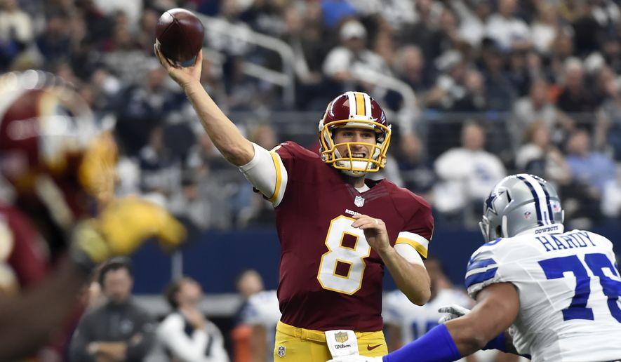 867e92addd3 Washington Redskins quarterback Kirk Cousins (8) looks to throw a pass  under pressure from