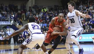 Maryland guard Rasheed Sulaimon, center, is defended by Northwestern guards Bryant McIntosh (30) and Jordan Ash (23) during the second half of an NCAA college basketball game Saturday, Jan. 2, 2016, in Evanston, Ill. Maryland won 72-59. (AP Photo/David Banks)