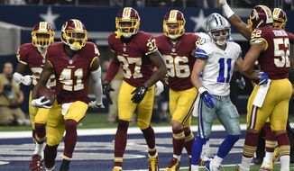 Washington Redskins' Will Blackmon (41) celebrates with Jeremy Harris (37), Houston Bates (96) and Keenan Robinson (52) after intercepting a pass intended for Dallas Cowboys wide receiver Cole Beasley (11) near the goal line in the second half of an NFL football game, Sunday, Jan. 3, 2016, in Arlington, Texas. (AP Photo/Michael Ainsworth)