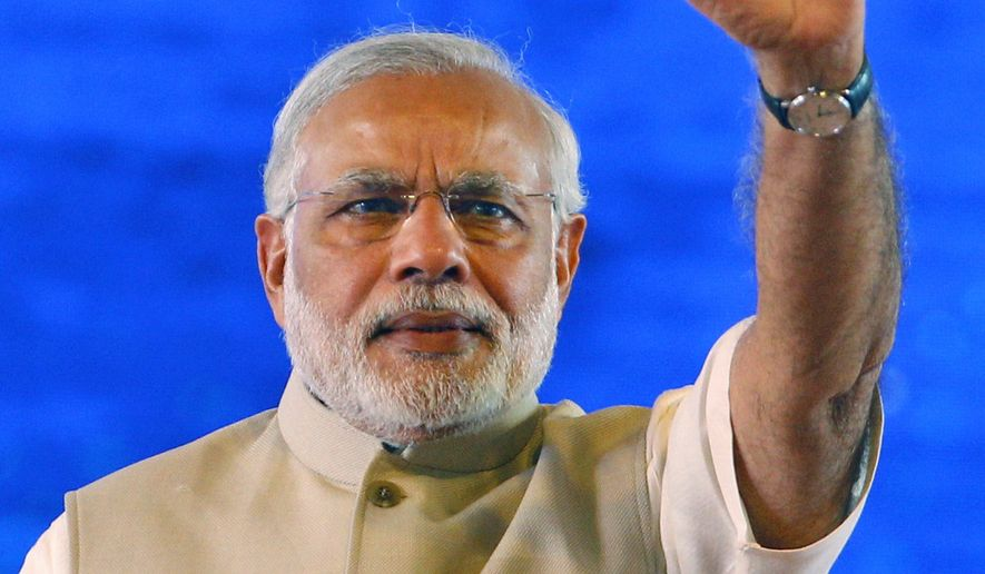 Indian Prime Minister Narendra Modi waves to the audience as he arrives to inaugurate the International Conference on Frontiers in Yoga Research and its Applications in Jigani, near Bangalore, India, Sunday, Jan. 3, 2016. The conference aims to make an effort to integrate Ayurveda, Naturopathy, Yoga, Unani, Siddha, Homeopathy and modern medicine by bringing prominent researchers and doctors from all these fields on one platform. (AP Photo/Aijaz Rahi)