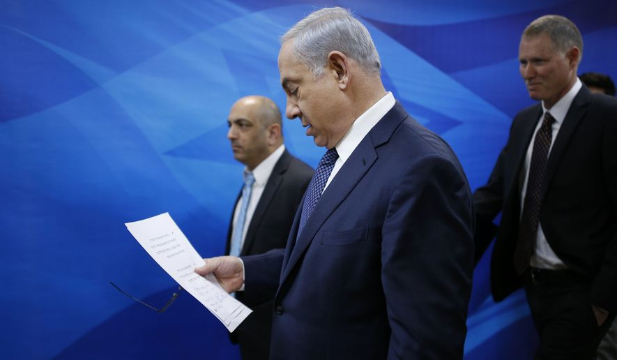 Israeli Prime Minister Benjamin Netanyahu arrives to the weekly cabinet meeting in Jerusalem, Sunday, Jan. 3, 2016. (Amir Cohen /Pool Photo via AP)