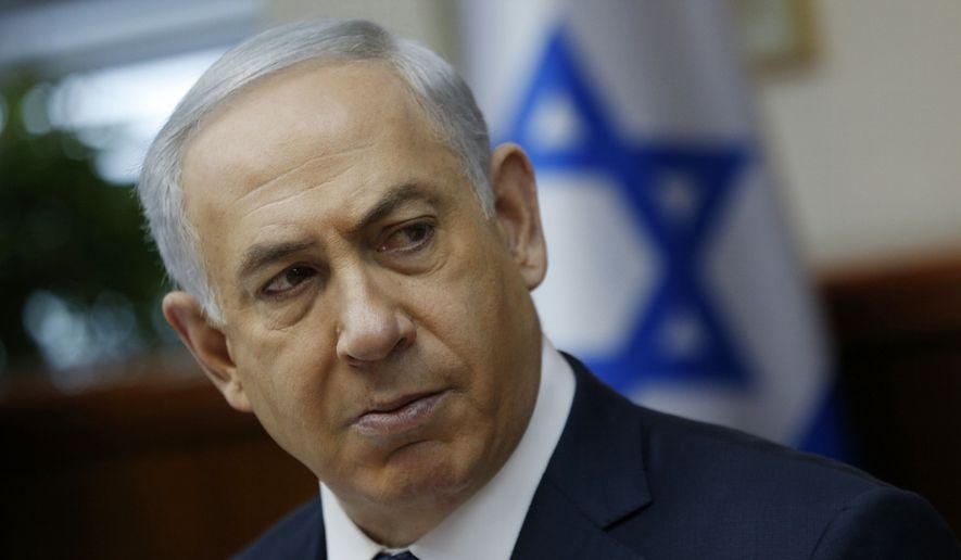 Israeli Prime Minister Benjamin Netanyahu attends the weekly cabinet meeting in Jerusalem, Sunday, Jan. 3, 2016. (Amir Cohen /Pool Photo via AP)