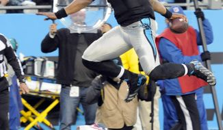 Carolina Panthers quarterback Cam Newton (1) leaps over Tampa Bay Buccaneers strong safety Chris Conte (23) into the end zone for a touchdown in the first half of an NFL football game in Charlotte, N.C., Sunday, Jan. 3, 2016. (AP Photo/Mike McCarn)