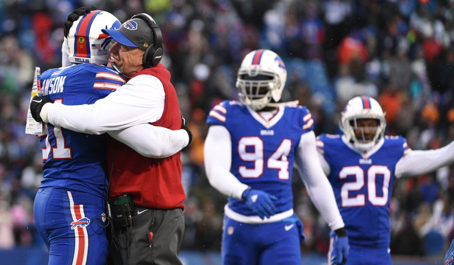 Buffalo Bills head coach Rex Ryan hugs Buffalo Bills' Manny Lawson (91) after Lawson intercepted a pass during the second half of an NFL football game against the New York Jets Sunday, Jan. 3, 2016, in Orchard Park, N.Y. The Bills won 22-17. (AP Photo/Gary Wiepert)