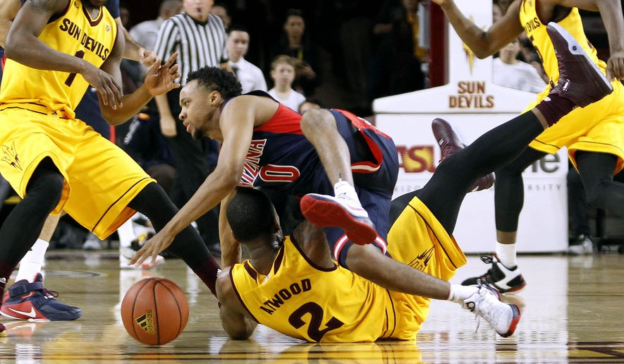 Arizona's Parker Jackson-Cartwright (0) collides with Arizona State's Willie Atwood (2) at mid-court during the first half of an NCAA college basketball game, Sunday, Jan. 3, 2016, in Tempe, Ariz. (AP Photo/Ralph Freso)