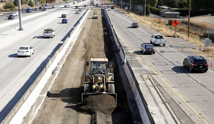 FILE - In this Oct. 15, 2015, file photo, vehicles pass a highway construction site on eastbound Interstate 80 in Sacramento, Calif. Lawmakers will return to the Capitol on Monday, Jan. 4, 2016, facing two unresolved problems from 2015: A $1 billion hole in funding the state's health care program and a $59 billion backlog in road repairs needed over the next decade. Gov. Jerry Brown called special sessions in 2015 to address both issues, but he and lawmakers never reached a deal on paying for either. (AP Photo/Rich Pedroncelli, File)