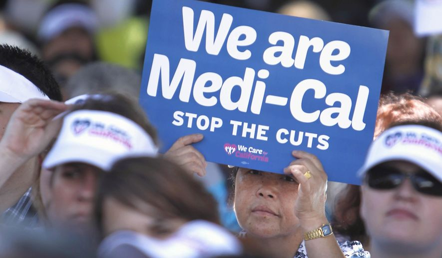 FILE - In this June 4, 2013, file photo, sign-carrying demonstrators representing doctors, hospitals and unionized health care workers rally against cuts in the amount the state pays for Medi-Cal reimbursements, at the Capitol in Sacramento, Calif. Lawmakers will return to the Capitol on Monday, Jan. 4, 2016, facing two unresolved problems from 2015: A $1 billion hole in funding the state's health care program and a $59 billion backlog in road repairs needed over the next decade. Gov. Jerry Brown called special sessions in 2015 to address both issues, but he and lawmakers never reached a deal on paying for either. (AP Photo/Rich Pedroncelli, File)