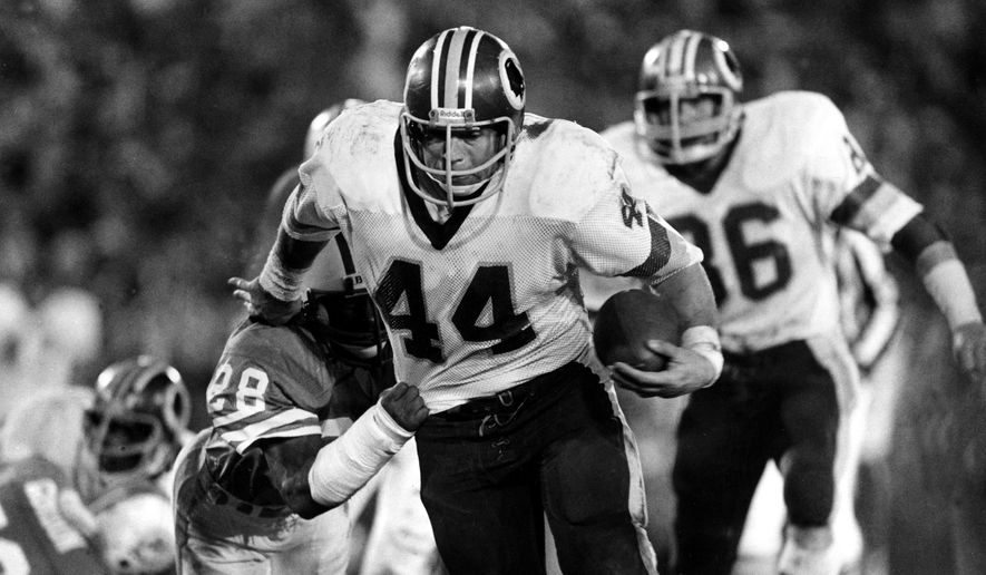 FILE - In this Jan. 30, 1983, file photo, Washington Redskins running back John Riggins (44) eludes a tackle-attempt by Miami Dolphins' Don McNeal (28) during NFL football's Super Bowl XVII in Pasadena, Calif. Riggins churned out a Super Bowl-record 166 yards on 38 carries to spark the Redskins to a come-from-behind 27-17 win over the Dolphins. (AP Photo/File)