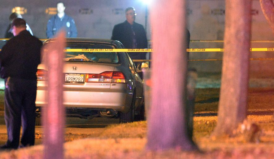 In this Saturday, Jan. 2, 2016 photo, police investigate the scene a shooting at Bellevue Memorial Park in Ontario, Calif. Authorities say a man and a woman killed by a former in-law in a murder-suicide at the cemetery were a married couple from North Hollywood visiting a grave. (Will Lester/The Inland Valley Daily Bulletin via AP)  MANDATORY CREDIT