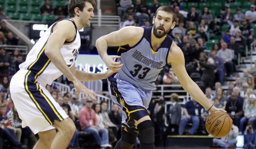 Memphis Grizzlies center Marc Gasol (33) drives around Utah Jazz center Jeff Withey, left, during the first quarter of an NBA basketball game Saturday, Jan. 2, 2016, in Salt Lake City. (AP Photo/Rick Bowmer)