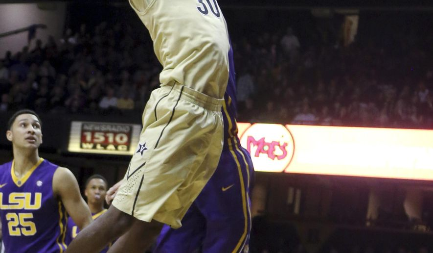 Vanderbilt's Damian Jones (30) goes in for a dunk as LSU's Ben Simmons (25) watches during an NCAA college basketball game Saturday, Jan. 2, 2016, in Nashville, Tenn. (Alan Poizner/The Tennessean via AP)