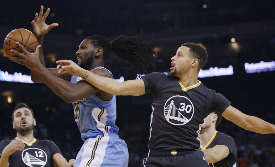 Denver Nuggets' Kenneth Faried (35) grabs a rebound next to Golden State Warriors' Stephen Curry (30) during the first half of an NBA basketball game Saturday, Jan. 2, 2016, in Oakland, Calif. (AP Photo/Marcio Jose Sanchez)