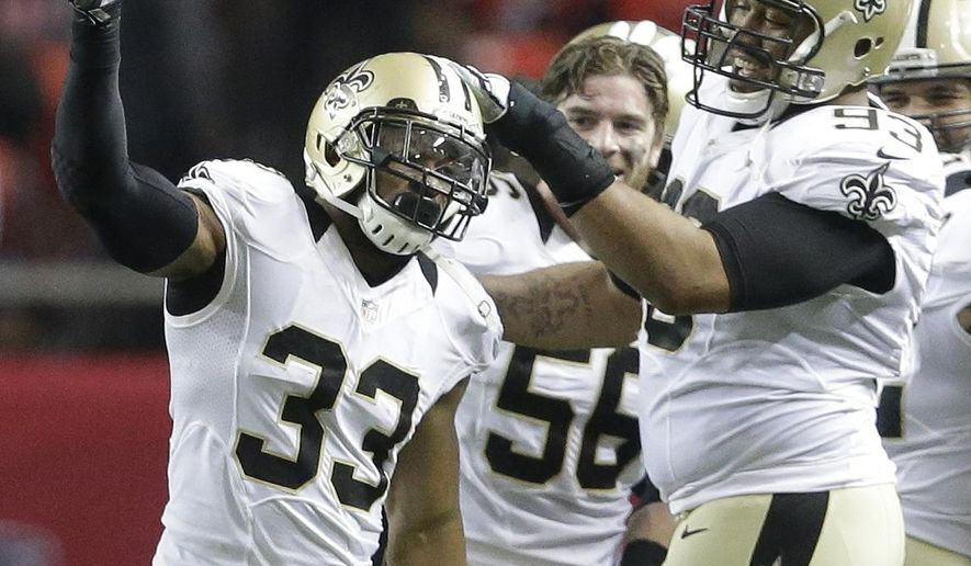 New Orleans Saints strong safety Jamarca Sanford (33) holds up the ball he intercepted against the Atlanta Falcons during the second half of an NFL football game, Sunday, Jan. 3, 2016, in Atlanta. The New Orleans Saints won 20-17. (AP Photo/David Goldman)