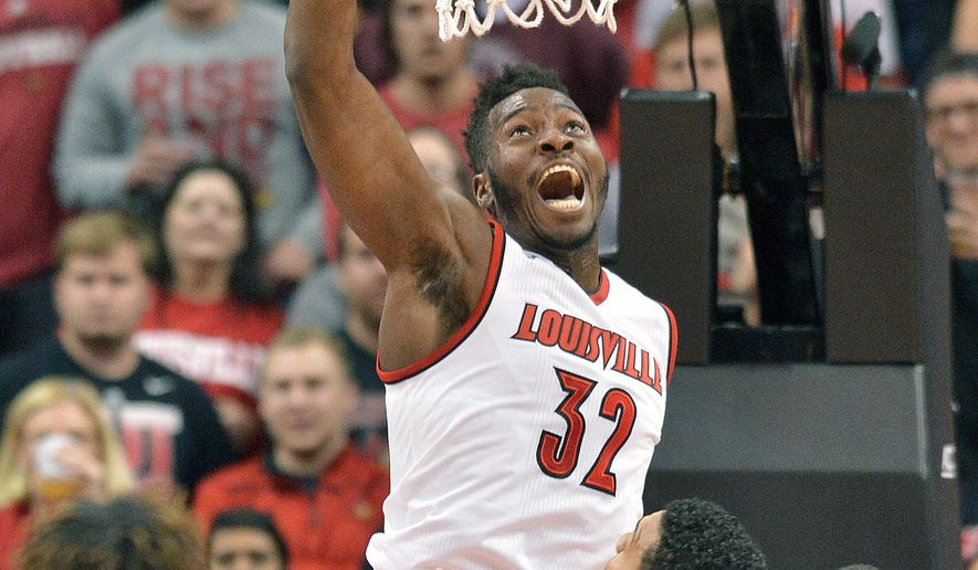 Louisville's Chinanu Onuaku (32) dunks over Wake Forest's Devin Thomas (2) during the first half of an NCAA college basketball game, Sunday, Jan. 3, 2016, in Louisville, Ky. (AP Photo/Timothy D. Easley)