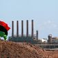 "Ras Lanuf is home to oil refineries and storage facilities in Libya. Islamic State militants on Monday set a storage tank ablaze as they pushed eastward into the ""oil crescent."" (Associated Press)"