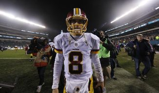 Washington Redskins' Kirk Cousins walks the field after an NFL football game against the Philadelphia Eagles, Saturday, Dec. 26, 2015, in Philadelphia. Washington won 38-24. (AP Photo/Michael Perez)