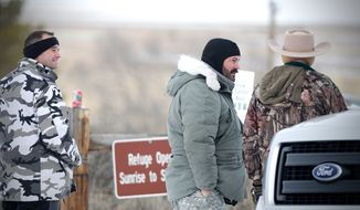 Protesters roam the Malheur National Wildlife headquarters in Burns, Ore., on Sunday, Jan 3, 2016. Armed protesters took over the Malheur National Wildlife Refuge on Saturday after participating in a peaceful rally over the prison sentences of local ranchers Dwight and Steven Hammond. The decision to send the man back to prison generated controversy and is part of a decades-long dispute between some Westerners and the federal government over the use of public lands. (Mark Graves/The Oregonian via AP)