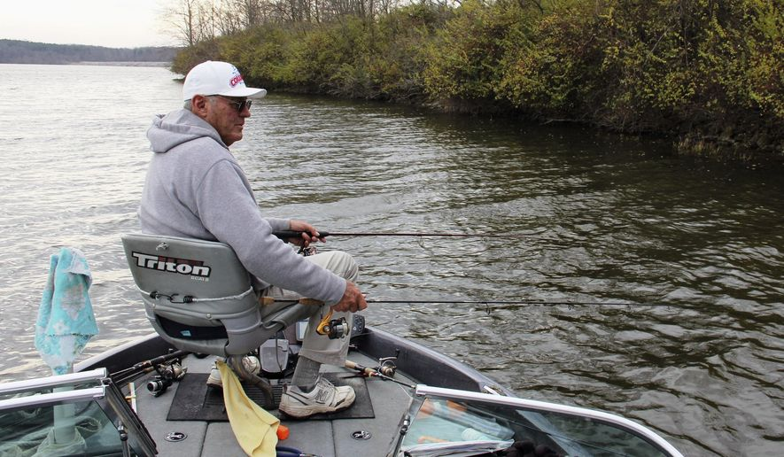 In this Dec. 10, 2015 photo, Dave Henson uses a two-handed approach to catching crappie on Crab Orchard Lake near Carterville, Ill. Although many anglers have mothballed their rods and reels for the season, Henson continues to mine for Crab Orchard crappie on a regular basis. (Les Winkeler/The Southern via AP) MANDATORY CREDIT