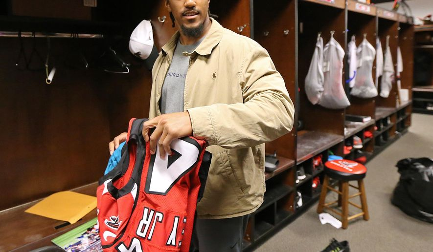 Atlanta Falcons NFL football player Vic Beasley Jr.  cleans out his locker the day after closing out the season with a loss to the New Orleans Saints to finish with an 8-8 record, Monday, Jan. 4, 2016, in Flowery Branch, Ga. (Curtis Compton/Atlanta Journal-Constitution via AP)  MARIETTA DAILY OUT; GWINNETT DAILY POST OUT; LOCAL TELEVISION OUT; WXIA-TV OUT; WGCL-TV OUT; MANDATORY CREDIT