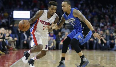Detroit Pistons guard Brandon Jennings (7) drives against Orlando Magic guard Shabazz Napier (13) during the first half of an NBA basketball game, Monday, Jan. 4, 2016, in Auburn Hills, Mich. (AP Photo/Carlos Osorio)