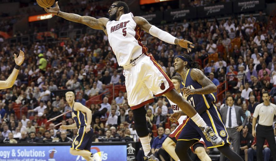 Miami Heat's Amar'e Stoudemire (5) gets a rebound in front of Indiana Pacers' Jordan Hill (27) during the first half of an NBA basketball game, Monday, Jan. 4, 2016, in Miami. (AP Photo/Lynne Sladky)