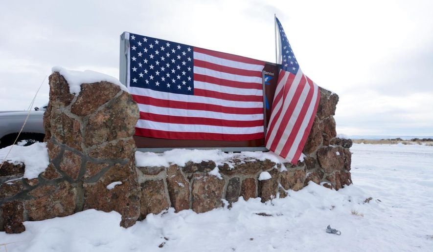 A small group of militia in Burns, Ore., who were there to support a local ranching family, took over the federal office of the Malheur National Wildlife Refuge headquarters Saturday, Jan. 3, 2016, in a development that stunned the community. Armed protesters took over the Malheur National Wildlife Refuge on Saturday after participating in a peaceful rally over the prison sentences of local ranchers Dwight and Steven Hammond. (Mark Graves/The Oregonian via AP) **FILE**