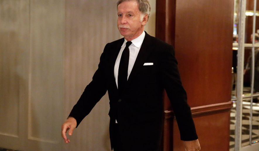 FILE - In this Oct. 7, 2015, file photo, St. Louis Rams owner Stan Kroenke walks in the hallway during a break of National Football League owners meeting, in New York. Monday, Jan. 4, 2016, is the first day for teams to apply for relocation and St. Louis Rams owner Stan Kroenke wants to move the franchise to Los Angeles. (AP Photo/Richard Drew, File)