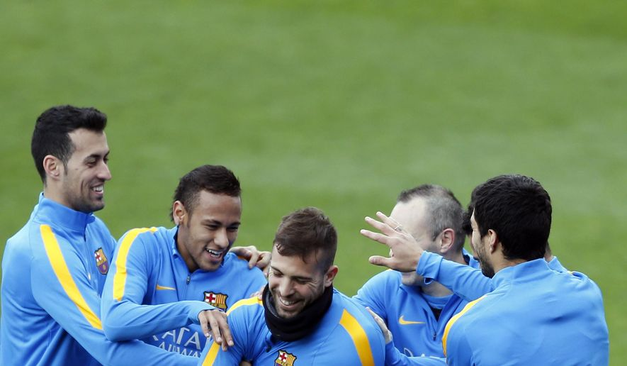 FC Barcelona's Jordi Alba, center, jokes with teammates Sergio Busquets left, and Neymar, second left, during a training session at Miniestadi stadium in Barcelona, Spain, Monday, Jan. 4, 2016. (AP Photo/Manu Fernandez)