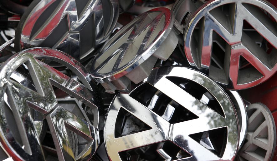 FILE - In this Sept. 23, 2015 file photo Volkswagen ornaments sit in a box in a scrap yard in Berlin, Germany. Federal authorities are suing Volkswagen over emissions-cheating software found in nearly 600,000 vehicles sold in the United States. The Justice Department and the Environmental Protection Agency on Monday filed a civil complaint against the German automaker in U.S. District Court in Detroit. (AP Photo/Michael Sohn, file)