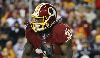 Washington Redskins running back Matt Jones (31) carries the ball during the first half of an NFL football game against the Dallas Cowboys in Landover, Md., Monday, Dec. 7, 2015. (AP Photo/Alex Brandon)