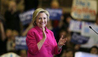 Democratic presidential candidate Hillary Clinton reacts to supporters after speaking at a campaign rally at the Iowa State Historical Museum, Monday, Jan. 4, 2016, in Des Moines, Iowa. (AP Photo/Charlie Neibergall)